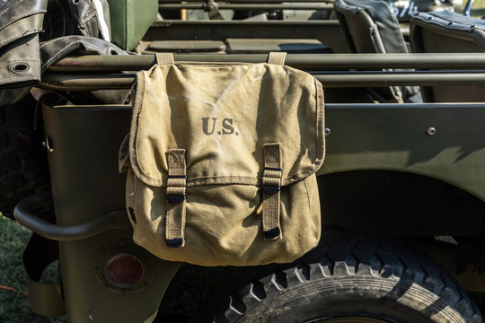 U.S military bag hang on a green vehicle