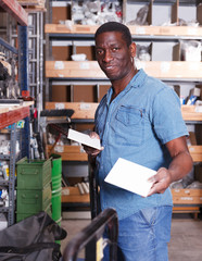 Man choosing building materials in shop