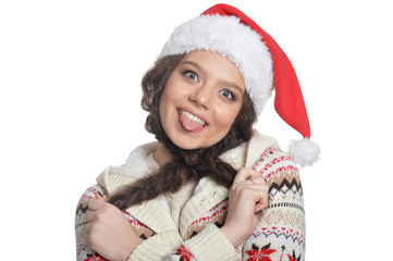 Portrait of young woman in Santa hat