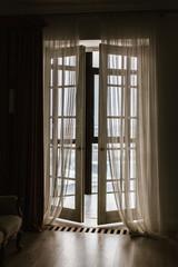 Door to the lodge, window to the floor