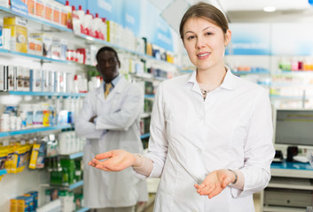 woman pharmacist inviting to drugstore