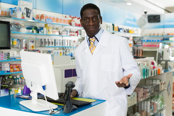 Male pharmacist  invites to pharmacy