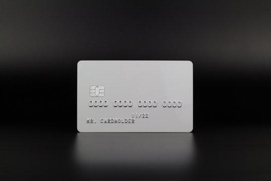 White credit card on luxury dark background