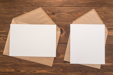 Envelopes on wooden background