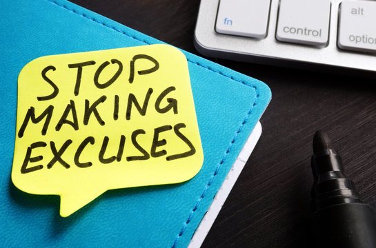 Stop making excuses written on a piece of paper.