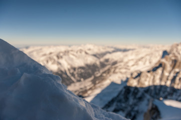 View over the French Alps, from the Aiguille du Midi cable on a winter afternoon, just before Christmas.