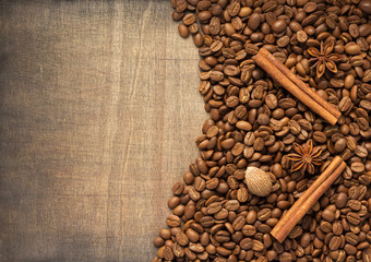 coffee beans and spices on wood