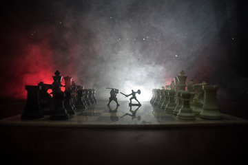 Medieval battle scene with cavalry and infantry on chessboard. Chess board game concept of business ideas and competition and strategy ideas Chess figures on a dark background