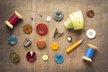 sewing tools and accessories on wooden table