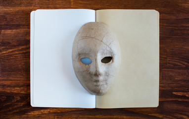blank notebook with mask and copy space