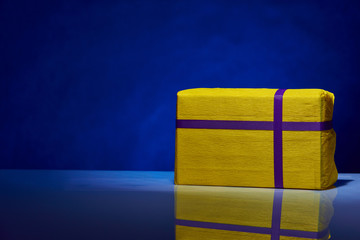 gorgeous design yellow box for gifts on a blue background