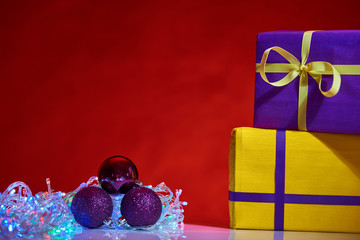 gorgeous design yellow and violet  Christmas boxes with decorations on red background
