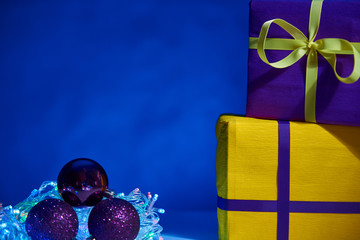 gorgeous design yellow and violet  Christmas boxes with decorations on blue background