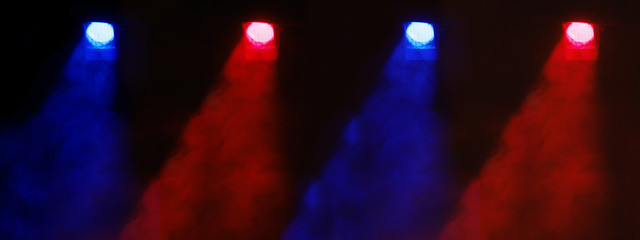 Theatrical light. Blue and red spotlights. A ray of light in the dark. Above the stage. Place for text.