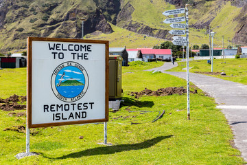 Welcome to the Remotest Island touristic signpost and distance to other places in the town centre of Edinburgh of the Seven Seas, Tristan da Cunha.