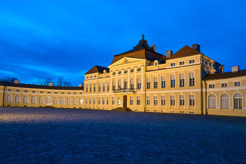 night view of the illuminated elevation of the baroque historic palace in Rogalin.