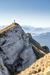 arrived at the summit, climber at the top of the Hengst, Schrattenfluh, Switzerland