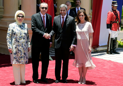 Turkish President Tayyip Erdogan, Emine Erdogan, Paraguay's President Mario Abdo Benitez and his wife Silvana pose for an photo during a welcoming ceremony at Presidential Palace in Asuncion