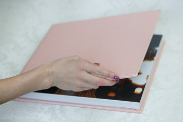 photo book with  leather cover unfolded photobook background for photo publishing sample photobook the person is looking at a photobook