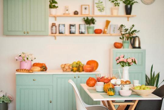autumn kitchen decoration with pumpkins