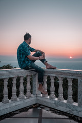 Men watch sunrise from the mountain , Wat Phra That Doi Suthep is famous visiting place and attraction of Chiang Mai, Thailand, Sunrise Doi Suthep Chiang Mai Thailand