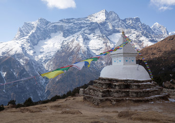 Buddhist white stupa with prayer flags above Namche Bazaar in Nepal Himalayas