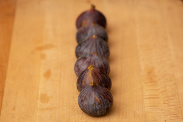Line of fruit fig on a wooden plank