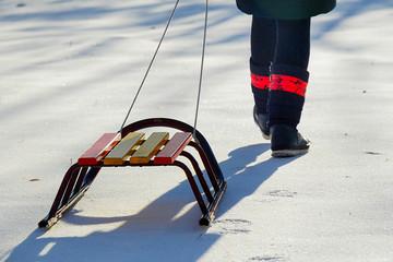 Child pulls sled broke snow snow in winter