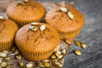 Pumpkin muffins on wooden background. Dietary product. Useful children's dessert. Bright. Seasonal product. Diet. Recipe