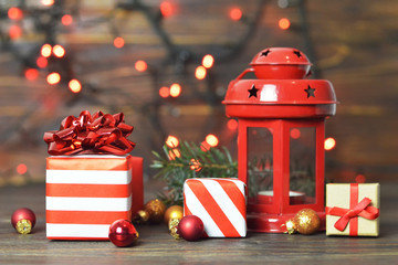 Christmas gifts and Christmas decoration on wooden background