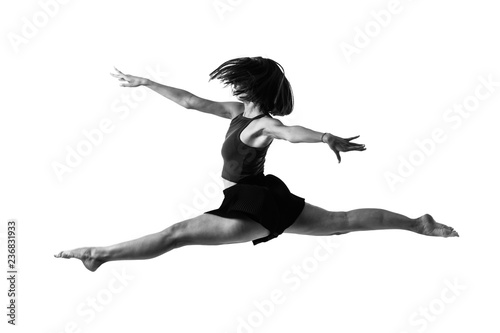 dcfcbb86 Young girl dancing and jumping in studio on isolated background in black  and white