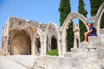 Fotobehang Cyprus Little girl in Bellapais Abbey in North Cyprus, Kyrenia