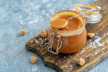 Glass jar with homemade salted caramel.