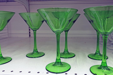 transparent green wine glasses for alcohol on the shelf