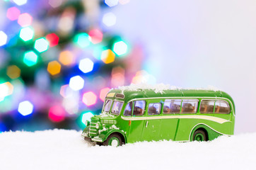 Photo of a green toy bus in the snow