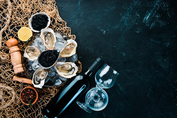 Fresh oysters with ice and red wine. Seafood. Top view. Free copy space.