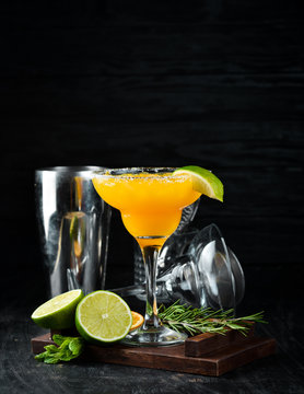 Margarita Mango. Alcoholic cocktail. On a wooden background. Top view. Free copy space.