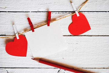 Paper hearts and sheet of paper