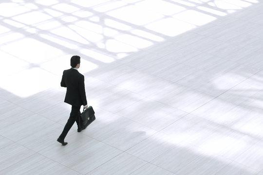 top view from afar.Executive businessman with portfolio