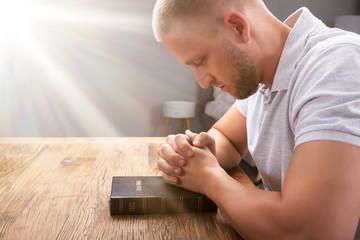 Man's Praying Hand On Bible Wall mural