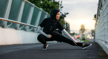 Hijab girl exercising outdoors in early morning
