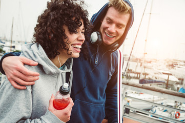 Casual young couple smiling outdoor walking in the harbor