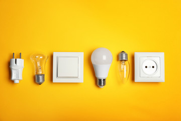 Flat lay composition with electrician's equipment on color background