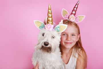 The Unicorn Girl and unicorn dog.