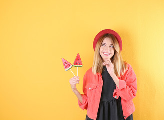 Young pretty woman with candies on colorful background. Space for text