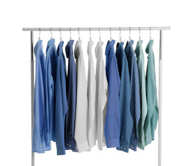 Men clothes hanging on wardrobe rack against white background