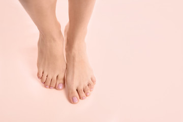 Woman with beautiful feet on color background, top view with space for text. Spa treatment Wall mural