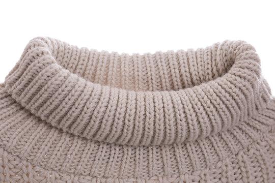 Cozy warm sweater on white background, closeup