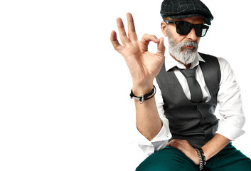 Old brutal senior millionaire man show ok sign in sunglasses stylish fashionable men isolated on white