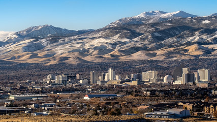 City of Reno Nevada, cityscape in the early winter with snow covered mountains, casinos and hotels.